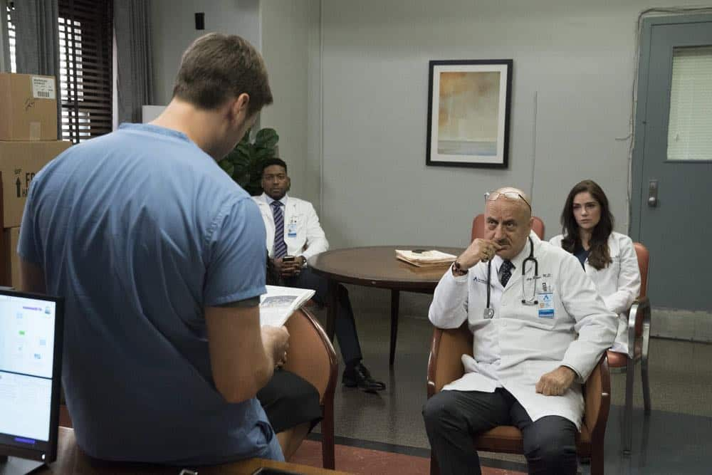 """NEW AMSTERDAM -- """"Cavitation"""" Episode 105 -- Pictured: (l-r) Ryan Eggold as Dr. Max Goodwin, Jocko Sims as Dr. Floyd Reynolds, Anupam Kher as Dr. Vijay Kapoor, Janet Montgomery as Dr. Lauren Bloom -- (Photo by: Virginia Sherwood/NBC)"""