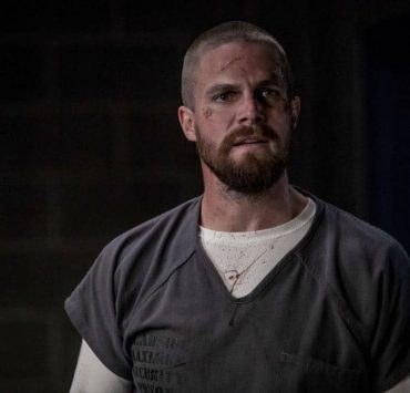 """Arrow -- """"Crossing Lines"""" -- Image Number: AR703a_0256b -- Pictured: Stephen Amell as Oliver Queen/Green Arrow -- Photo: Jack Rowand/The CW -- © 2018 The CW Network, LLC. All Rights Reserved."""