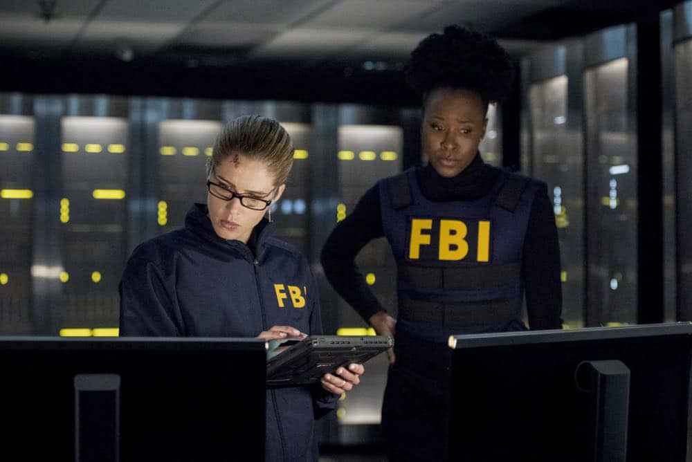 "Arrow -- ""Crossing Lines"" -- Image Number: AR703b_0134b -- Pictured (L-R): Emily Bett Rickards as Felicity Smoak and  Sydelle Noel as FBI Agent Samanda Watson -- Photo: Dean Buscher/The CW -- © 2018 The CW Network, LLC. All Rights Reserved."