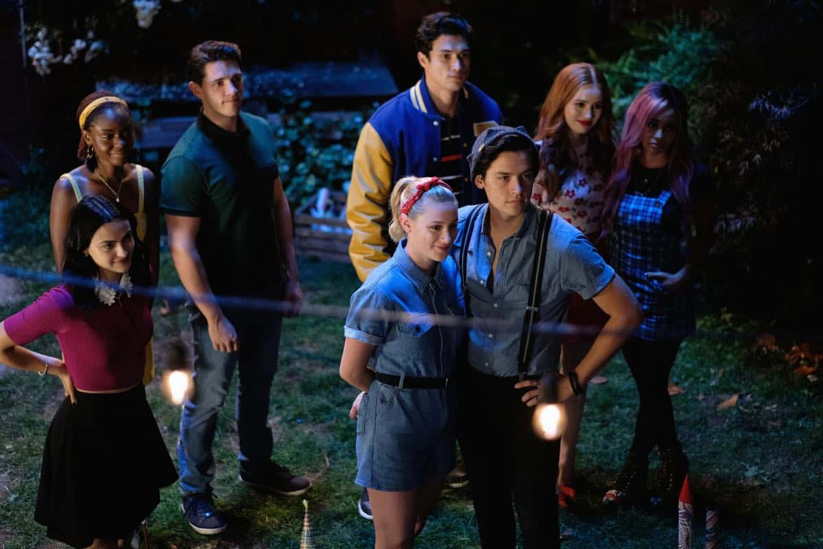 """Riverdale -- """"Chapter Fifty-Eight: In Memoriam"""" -- Image Number: RVD401b_0209.jpg -- Pictured (L-R): Camila Mendes as Veronica, Ashleigh Murray as Josie, Casey Cott as Kevin, Charles Melton as Reggie, Lili Reinhart as Betty, Cole Sprouse as Jughead, Madelaine Petsch as Cheryl and Vanessa Morgan as Toni -- Photo: Robert Falconer/The CW -- © 2019 The CW Network, LLC. All Rights Reserved."""